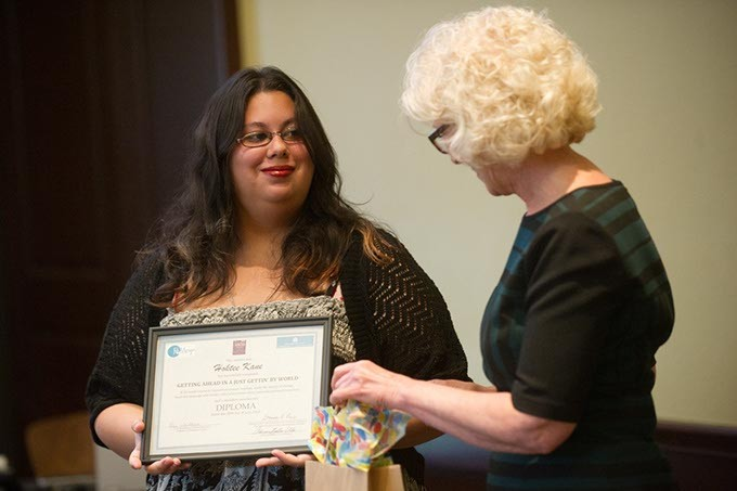 Deborah Price presents Hoktee Kane her diploma during a ReMerge graduation at the Oklahoma City Community Foundation, Thursday, June 30, 2016. - GARETT FISBECK