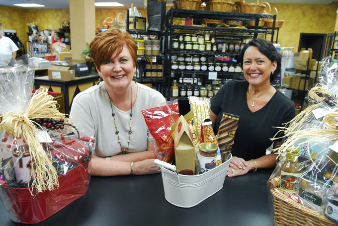 Janet McDonald, left, and Cindy Utecht with gift basets at their business, Gourmet Gallery, 1532 S. Boulevard in Edmond.  mh