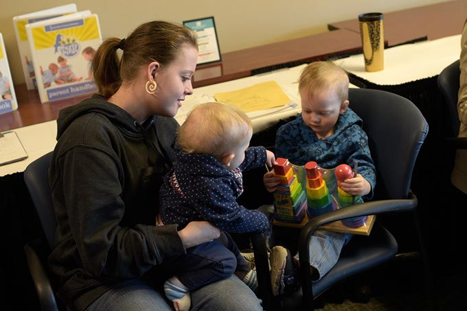 Susan Dougherty plays with her children Logan Hinkle, 2, and Alex Hinkle, 1, during an Early Bird class at Metro Career Academy, Friday, Feb. 3, 2017. - GARETT FISBECK