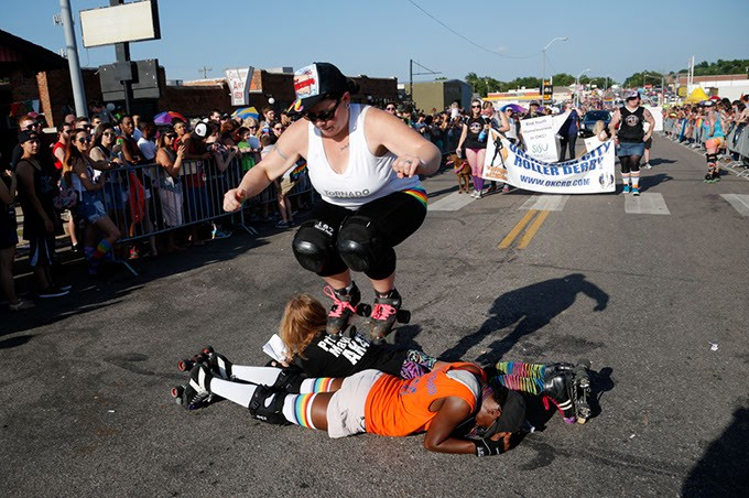 "Twisted Armani jumps over Lita-Lita Ho' Beta and Princess Mayhem during 2015 OKC Pride Parade. OKC Pride's theme for 2017 is ""30 years of resistance."" The nonprofit organization is celebrating 30 years of Pride celebrations this year. - GARETT FISBECK / FILE"