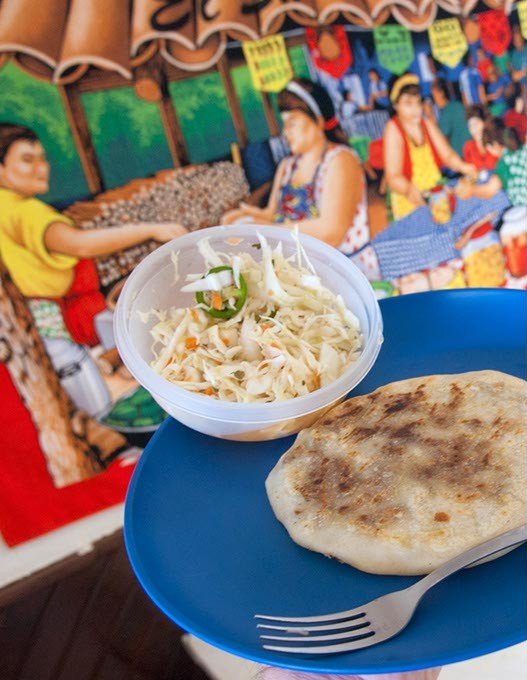 At El Buen Gusto the specialty is pupusas.  This one is the revueltas served with cabage and peppers and two sauces.  mh