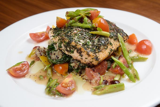 Herb-crusted salmon over sauteed spinach and quinoa at E.S. Founders in Oklahoma City, Friday, July 22, 2016. - GARETT FISBECK