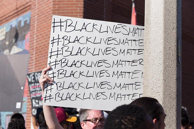 Protestor holds a sign at the Black Lives Matter protest on Sunday, July 10, 2016 in Oklahoma City. - EMMY VERDIN