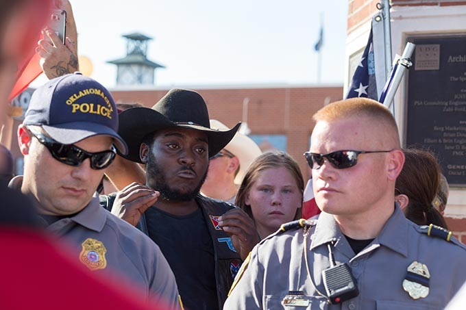 Police stand guard as tension flared around Confederate flag carrying protestors at the Black Lives Matter protest on Sunday, July 10, 2016 in Oklahoma City. - EMMY VERDIN