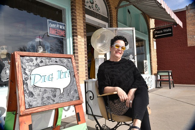Amanda Martinez relaxes outside her store Dig It! in the 16th Street Plaza District, one of the city's most popular districts. (Photo Laura Eastes)