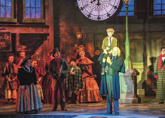 center Anthony Newmann plays Tiny Tim and Dirk Lumbard plays Ebenezer Scrooge in Lyric Theatre's A Christmas Carol. | Photo KO Rinearson / Lyric Theatre of Oklahoma / provided
