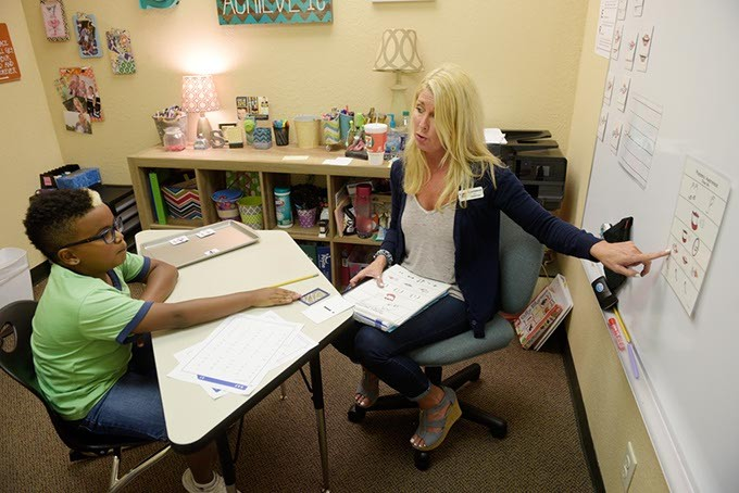 Therapy intern Rachel Southworth works with student Kaevion Tyner at ReadWrite Center. | Photo Gazette / file