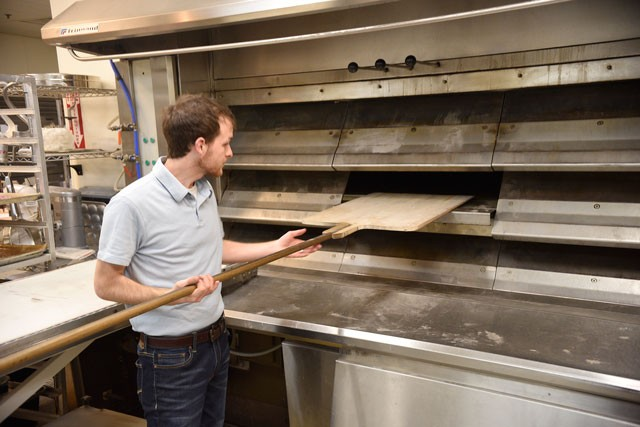 Baker Cameron Campbell shows off Esca Vitae's three-deck oven imported from France. (Photo Jacob Threadgill)