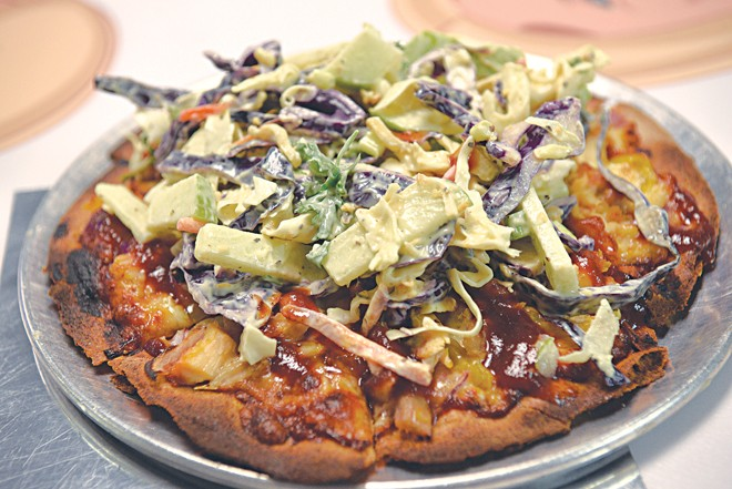 The Thanks Gramps pizza features coleslaw added post-bake. (Jacob Threadgill)