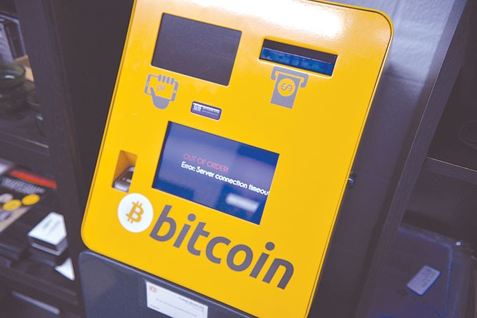 A bitcoin vending machine installed by L'Argent Services at Coin and Gold Exchange at 7714 N. May Photo Jacob Threadgill