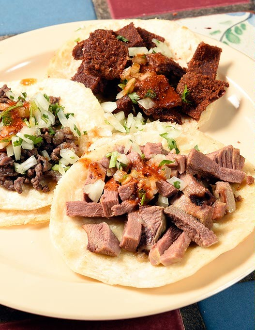 Azada, Milaneza, and Lengua tacos at Carnitas Michoacan in Edmond, Thursday, May 26, 2016. - GARETT FISBECK