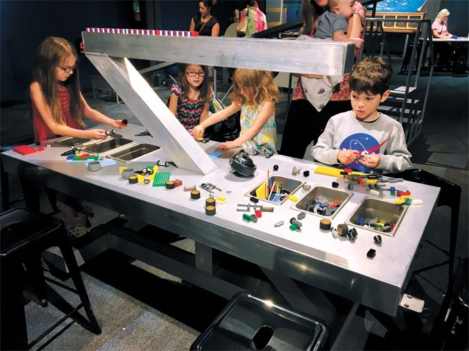 Children use Legos in experiments in the Kid Inventor exhibit at Science Museum Oklahoma. | Photo Science Museum Oklahoma / provided