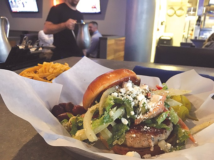 Johnnie the Greek burger and a side of Frito pie. ( Jacob Threadgill )