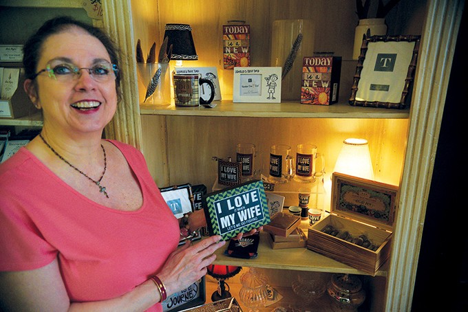 42 Street Candy Co. owner Teresa Wall - shows off some remaining merchandise - before the brick-and-mortar store closes - its doors to the public on April 27. - JACOB THREADGILL