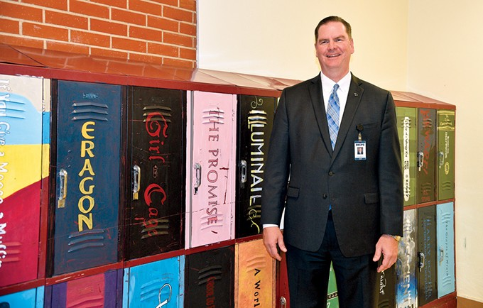 New Oklahoma City Public Schools superintendent Sean McDaniel stands in front of student-painted lockers inside - Northeast Academy. - BEN LUSCHEN