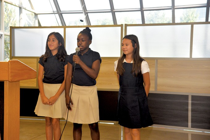 John Rex Charter School sixth-graders from left Adamari Hernandez, Jamya Boyd and Alyssa Penrod delivered the school's creed to a crowd at the Aug. 2 unveiling of the new middle school's classroom at Myriad Botanical Gardens. - NAZARENE HARRIS