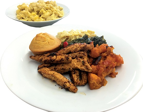 A Health Koncious plate featuring Cajun seitan bites, candied yams, collard greens, macaroni and cheese and cornbread. - JACOB THREADGILL