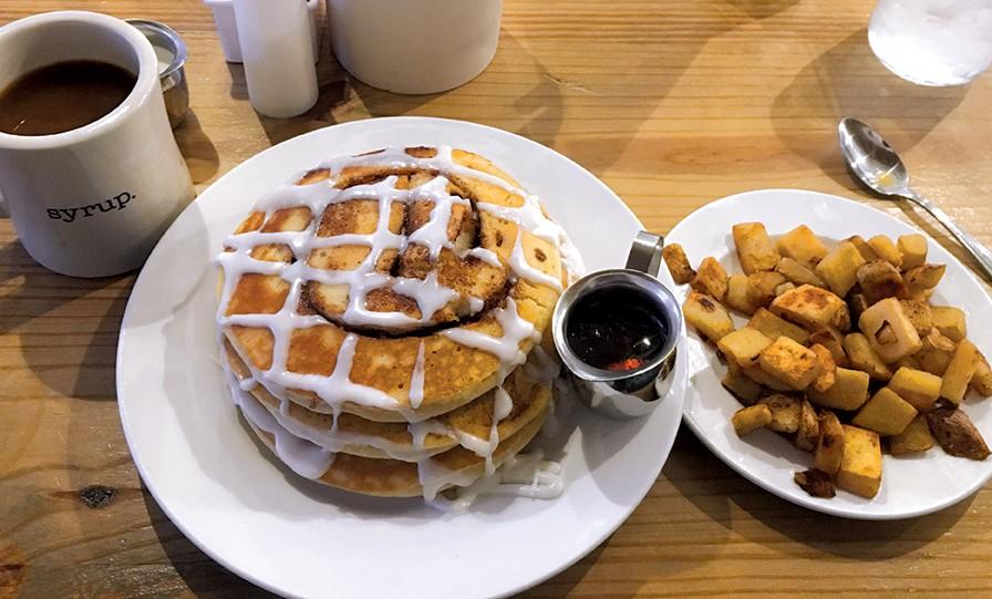 Cinnamon roll pancakes at syrup.'s Oklahoma City location. - JACOB THREADGILL