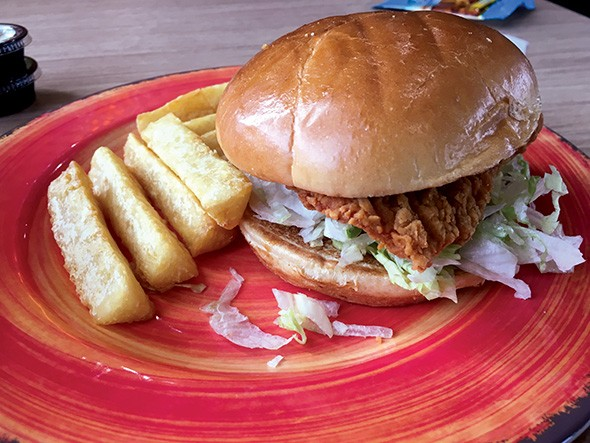 Pollo Campero's new extra-crispy chicken sandwich features a thicker breading than the one found on its regular fried chicken. - JACOB THREADGILL