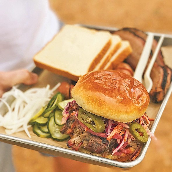 A brisket sandwich topped with coleslaw from Maples Barbecue - PROVIDED