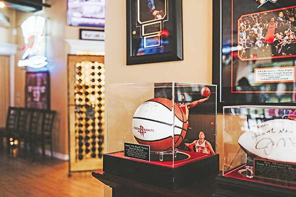 Freddy Nguyen's friendships with sports legends are reflected in Park Harvey Sushi's decor and memorabilia. - ALEXA ACE