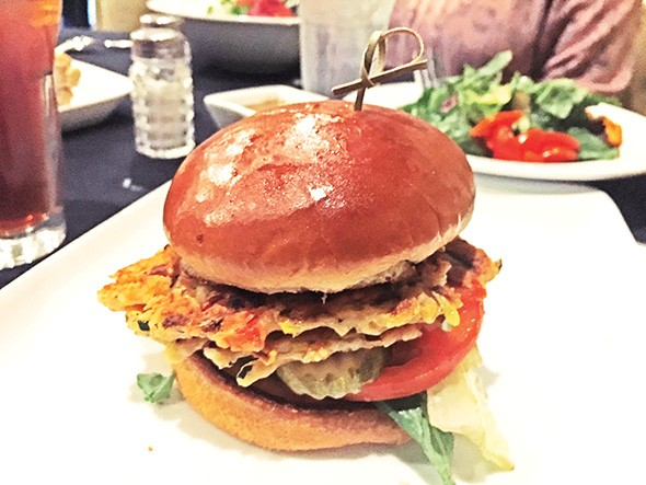 The veggie burger features two patties with a - hummus base and sauteed vegetables. - JACOB THREADGILL
