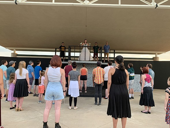 Upstage Theatre artistic director Jenny Rottmayer addresses the crowd as Eva Perón in a rehearsal for Evita. - PROVIDED