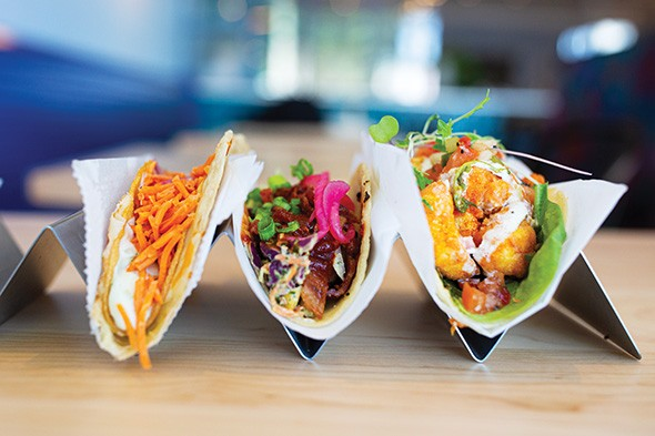Crunch wrap, barbecue shrimp and crispy cod tacos at Mexican Radio - ALEXA ACE