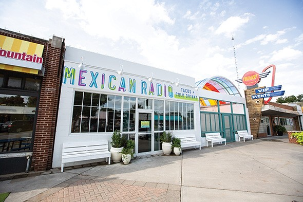 Mexican Radio's patio is covered with a rainbow canopy that connects the restaurant to its vibrant 16th Street Plaza District neighborhood. - ALEXA ACE