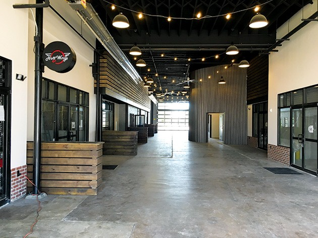 Hott Wings, a concept by the Eddie's Bar & Grill owners, was the first restaurant to open in Edmond Railyard. - PETE BRZYCKI