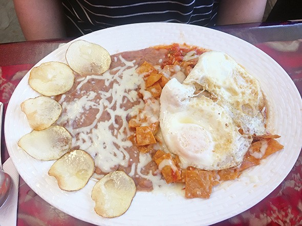 Chilaquiles with eggs and red sauce - JACOB THREADGILL