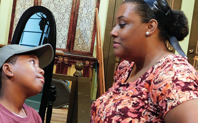 Myles Currin-Moore (Travis Younger) and Nykezia Giles (Ruth Younger) share a moment in A Raisin in the Sun.