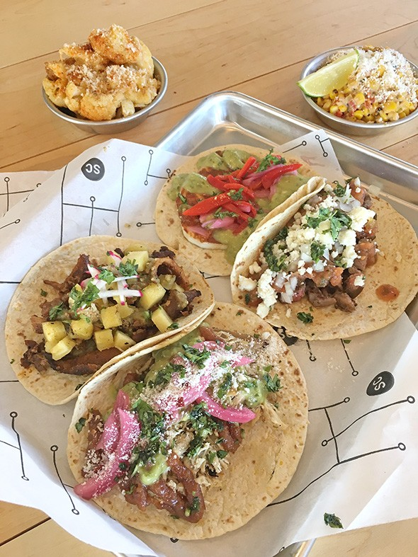 Al pastor, beer-can chicken, cotija and carne asada tacos with Nashville hot fried cauliflower and elote roasted corn at Social Capital - JACOB THREADGILL