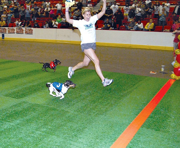 Manford and Kelsy Strecker cross the finish line to win the 2009 Dachshund Dash. - PHOTO GAZETTE / FILE