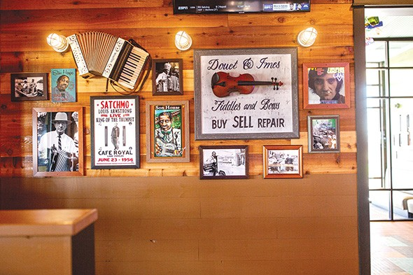 Blues and jazz artifacts line the wall at Razzoo's Cajun Cafe in Oklahoma City. - ALEXA ACE