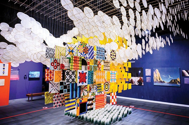 Cosmic Culture — on display through March 29, 2020, in the smART Space gallery at Science Museum Oklahoma — orbits around Jacob Hashimoto's The Other Sun, an installation constructed from 2,000 bamboo and paper kites. - PROVIDED
