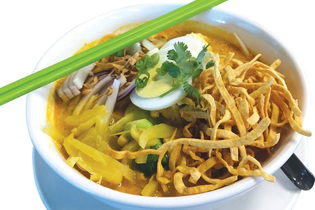 The special Khao Soi, a red curry-based soup with egg noodles, chicken and bok choy - JACOB THREADGILL