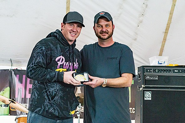 from left Jeremy Jones of Purple Tangie with Cowboy Cup founder Daniel Lewis after winning the grand champion flower category Dec. 14 - PROVIDED