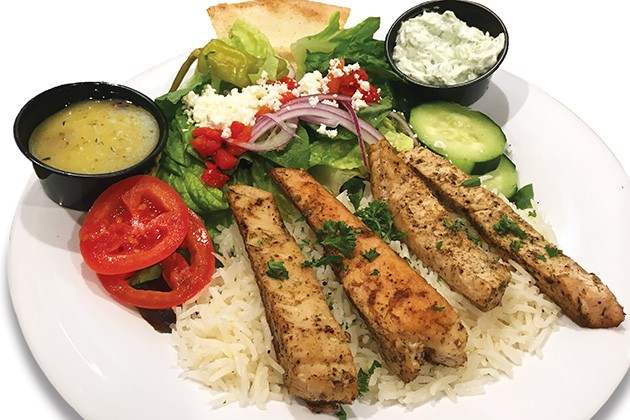 A chicken feast meal with basmati rice from Taziki's Mediterranean Cafe - JACOB THREADGILL