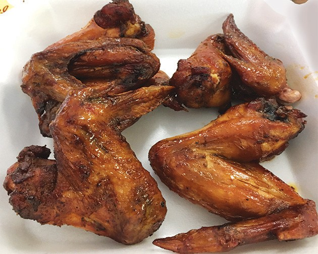 George's Happy Hog offers smoked wings on Tuesdays and Wednesdays. - JACOB THREADGILL