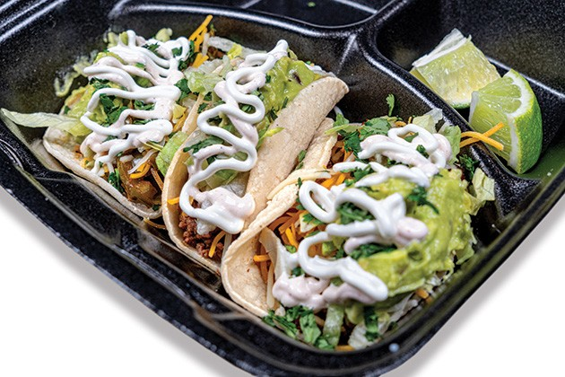 At Oklasoul Cafe, Tuesdays are for tacos topped with guacamole, lettuce, chipotle mayo and cheese. - PHILLIP DANNER