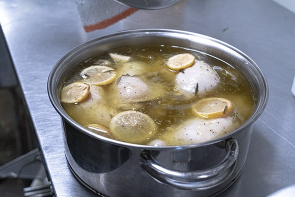 Vegetables and chicken are baked in a large pot or Dutch oven for two and a half hours. - PHILLIP DANNER