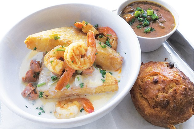 Shrimp with fried grits, a cup of gumbo and crawfish jalapeño cornbread at Magnolia Bistro - JACOB THREADGILL