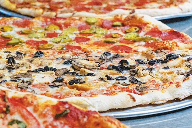 Pizza is available by the slice and whole pie at New York Pizza & Pasta. - PHILLIP DANNER