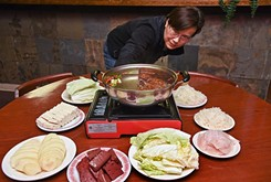 Family-style Chinese hot pots warm your insides and your soul