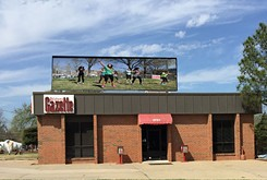<em>Oklahoma Gazette</em> installs Jumbotron in Crown Heights
