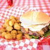 The French Brie Cheeseburger topped with crispy apples and a special sauce and a side of fried okra.