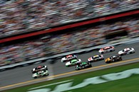 Kyle Busch, driver of the no. 18 Interstate Batteries Toyota, and Dale Earnhardt Jr., driver of the no. 88 National Guard Chevrolet, lead a group of cars at Daytona International Speedway in July. - JARED C. TILTON/NASCAR VIA GETTY IMAGES