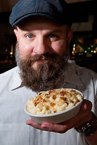 General Manager Tanner Fleming with Mac & Cheese at Whiskey Cake Kitchen & Bar.  mh