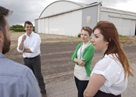 From left, Jonathan Dodson, Blair Humphreys, Allison Bailey, and Ashley discuse the proposed Wheeler District development at the Downtown Airpark.  mh
